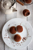 Muffins with spelt flour and cocoa on a table Royalty Free Stock Photos