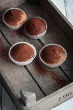 Muffins with spelt flour and cocoa in a wooden box on a table Stock Images