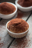 Muffins with spelt flour and cocoa in a wooden box on a table. Closeup stock photography
