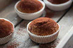 Muffins with spelt flour and cocoa in a wooden box on a table Stock Photos