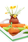 Muffins and spring flowers Stock Photos