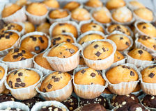 Muffins stacked together butter and chocolate in the foreground Royalty Free Stock Photos