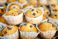 Muffins stacked together butter and chocolate in the foreground Stock Images
