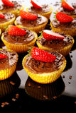 Muffins with strawberry royalty free stock photography