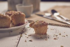 Muffins with sugary chips and coffee stock images