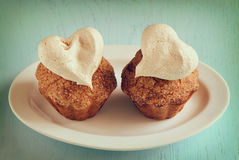 Muffins with sweet hearts Stock Image