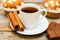 Muffins with tea, cinnamon sticks and chocolate Stock Photo