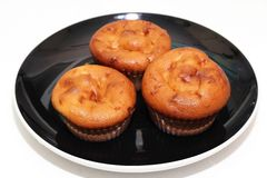 Muffins with tea or coffee. On white table Stock Image
