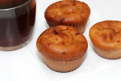 Muffins with tea or coffee. On white table Royalty Free Stock Photography