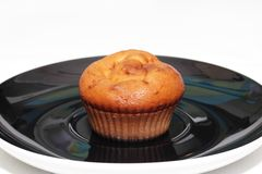 Muffins with tea or coffee. On white table Royalty Free Stock Images