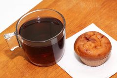 Muffins with tea or coffee. On white table Royalty Free Stock Image