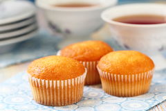 Muffins and tea Stock Images