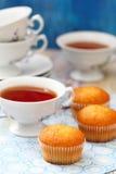 Muffins and tea Stock Photos