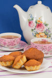 Muffins and tea. Three muffins on a saucer and tea royalty free stock image