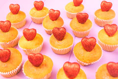 Muffins top view with sparkling red hearts top view toned selective focus Stock Image