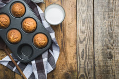 Muffins in a tray lying on wooden table Royalty Free Stock Photo