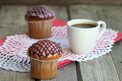 Muffins. Two cake, strawberry and chocolate glaze Shallow DOF royalty free stock photography
