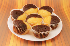 Muffins on a white plate stock photos