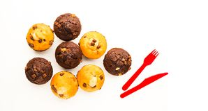 Muffins on white reflective surface royalty free stock photography