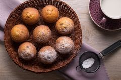 Muffins in a wicker plate with a cup of milk. Top view stock photos