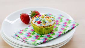 Muffins on wood and plates Royalty Free Stock Images
