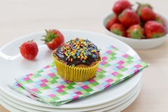 Muffins on wood and plates Royalty Free Stock Photo