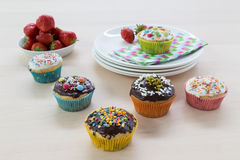 Muffins on wood and plates Stock Images