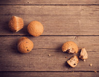 Muffins on wooden background Stock Images