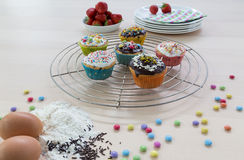 Muffins on wooden and cooling grid Royalty Free Stock Images