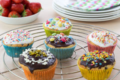 Muffins on wooden and cooling grid Stock Photo