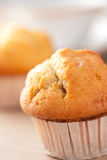 Muffins on wooden table Stock Images