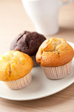 Muffins on wooden table Stock Photos
