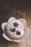 Muffins on a wooden table covered with sugar. Shallow depth of field Royalty Free Stock Photo