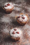 Muffins on a wooden table covered with sugar. Shallow depth of field Stock Photos
