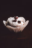 Muffins on a wooden table covered with sugar. Shallow depth of field Stock Photography