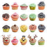 Muffinsamling mot vitbakgrund Fotografering för Bildbyråer