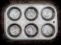 Muffinwannenhintergrund Stockbild