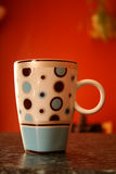 Mug. A picture of a spotty mug stock photography