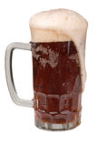 Mug of Ale with a frothy head. With clipping path Royalty Free Stock Photography