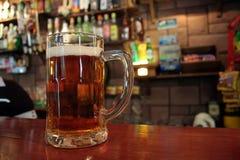 Mug of beer. On the bartop Stock Photo