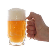 Mug with beer. Holding by hand isolated on white Stock Photo