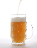Mug with beer. Isolated on white Stock Image