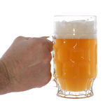 Mug with beer. Holding by hand isolated on white Stock Image