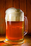Mug of beer. On a pub table Stock Photo