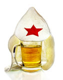 Mug with beer and   a bathing cap with red star Stock Images