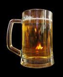 A mug of beer on a black background Royalty Free Stock Image