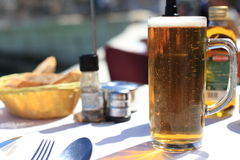 Mug of beer in a cafe Royalty Free Stock Photos