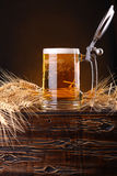 Mug of beer on a chest Royalty Free Stock Photography