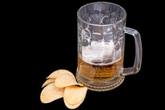 Mug with beer and chips Royalty Free Stock Photos