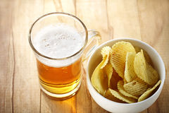 Mug of beer and chips Stock Photos